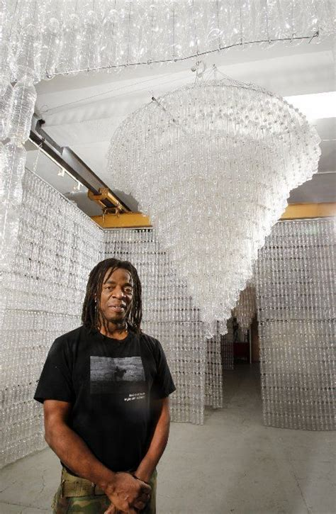 Earth Day: Artist Willie Cole recycles water bottles into