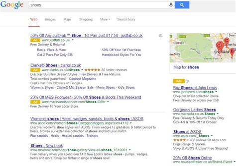 """Google AdWords Yellow """"Ad"""" Icon Spotted On Desktop SERPs In UK"""